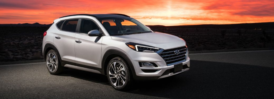 Passenger side exterior view of a gray 2019 Hyundai Tucson
