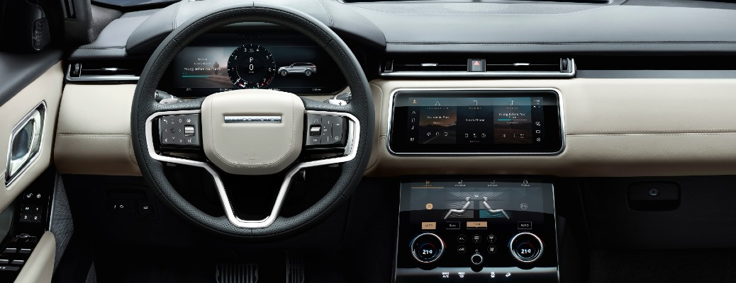 Land Rover Range Rover Velar interior shot of steering wheel, infotainment system, and dashboard