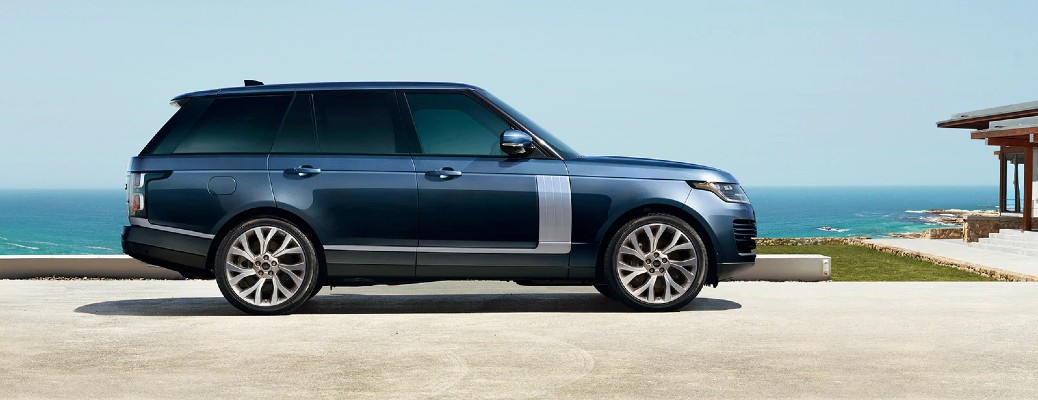 2021 Land Rover Range Rover Westminster Edition exterior side shot parked at a seaside villa
