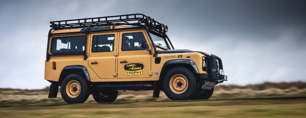 2021 Land Rover Classic Defender Works V8 Trophy model driving on a country road