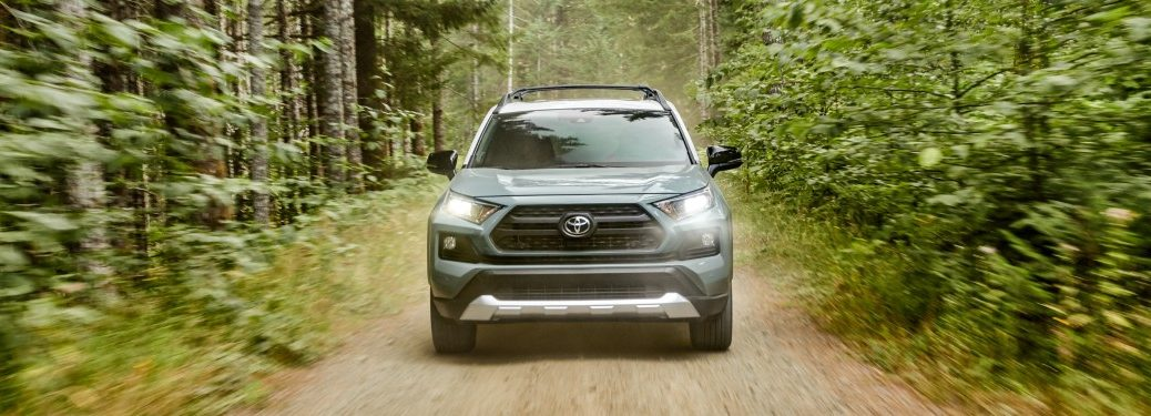 Front view of a 2019 Toyota RAV4 driving through woods