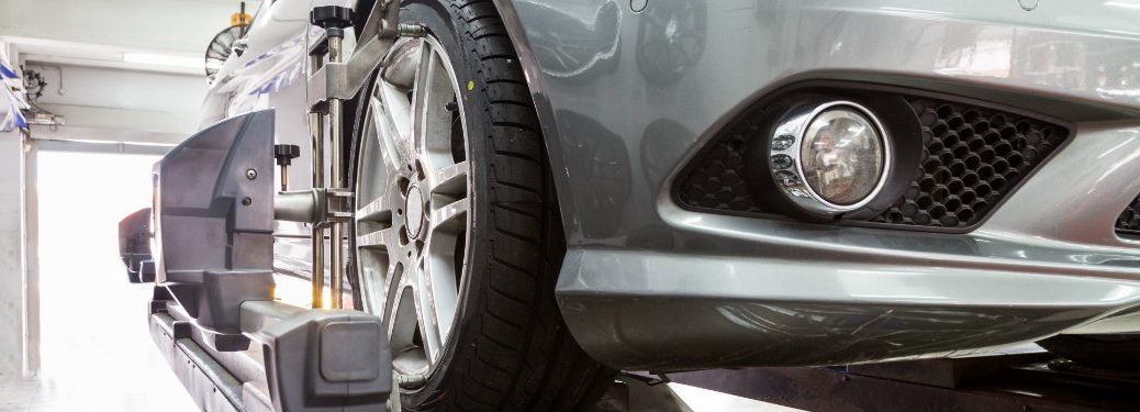 tires on silver car being serviced