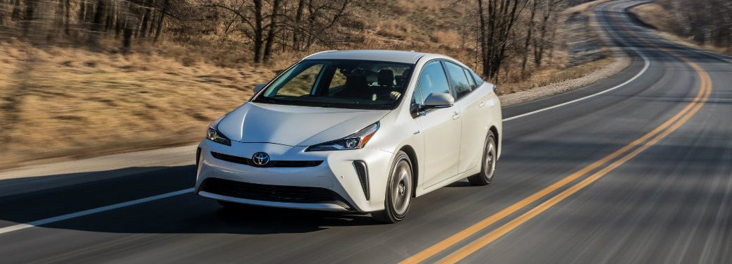 front view of white toyota prius driving