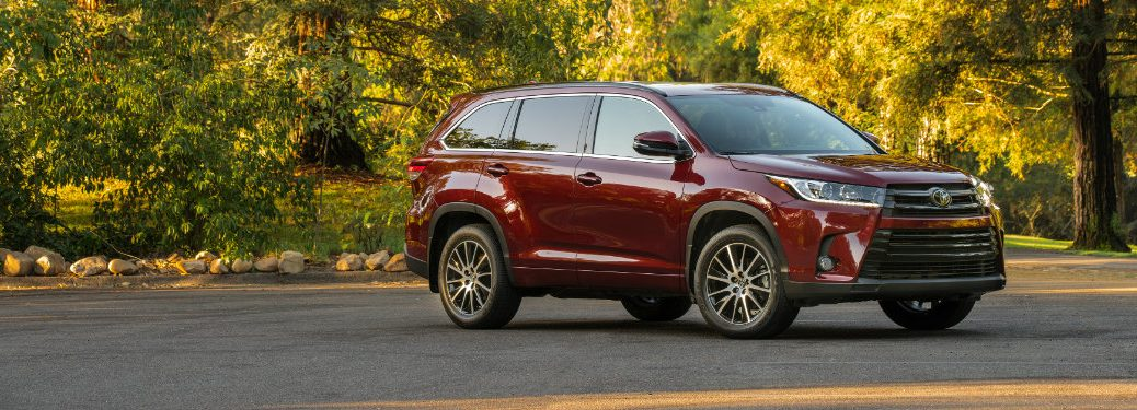 right side view of red toyota highlander