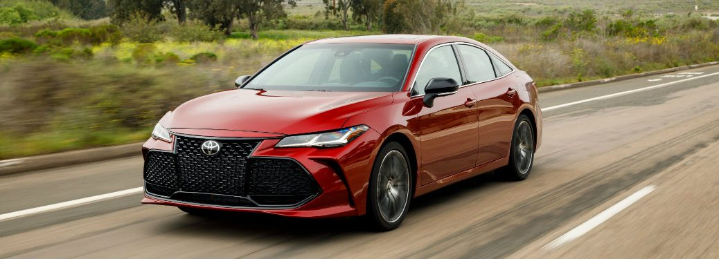 front view of red toyota avalon driving