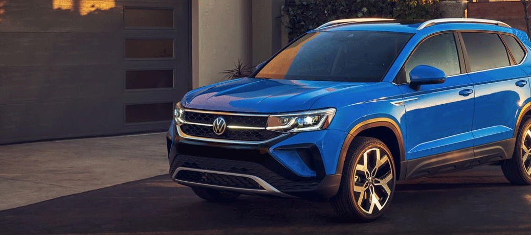 Blue VW Taos from Left front