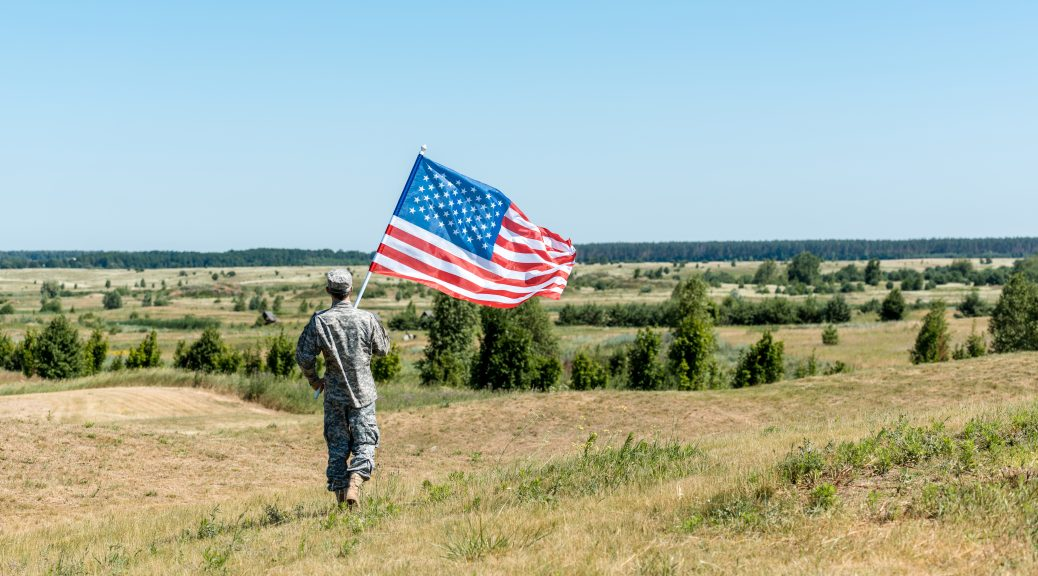 Military Personnel with US Flag