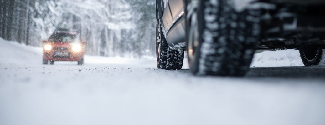 Vehicle-driving-on-snow-tires-view