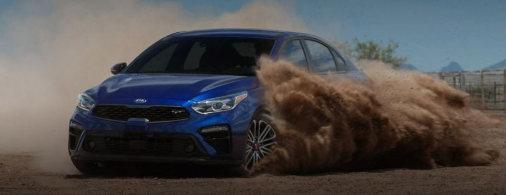 2021 Kia Forte driving in dirt