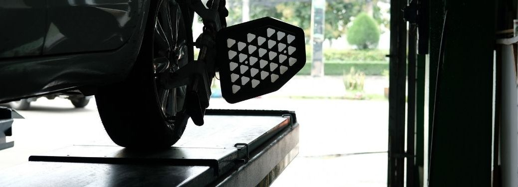 Car Tire Clamped With Aligner