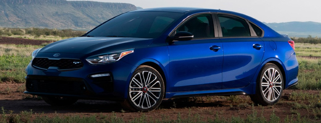 A blue-colored 2021 Kia Forte parked outside