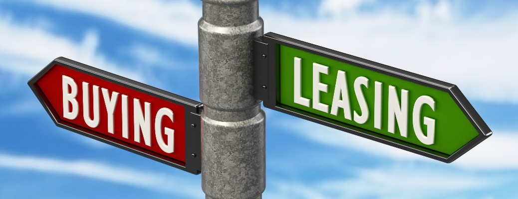 Street signs that say Buying and Leasing