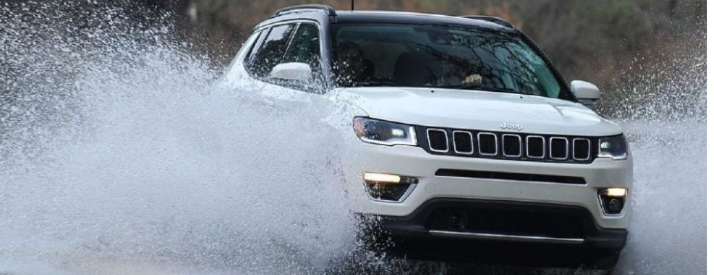 Image of the 2021 Jeep Compass speeding through a splash of water