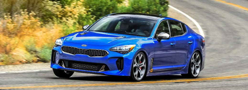 blue kia stinger gt2 on country road