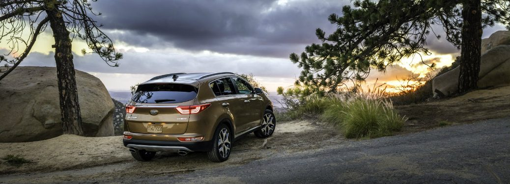 shot of rear of kia sportage in mountains