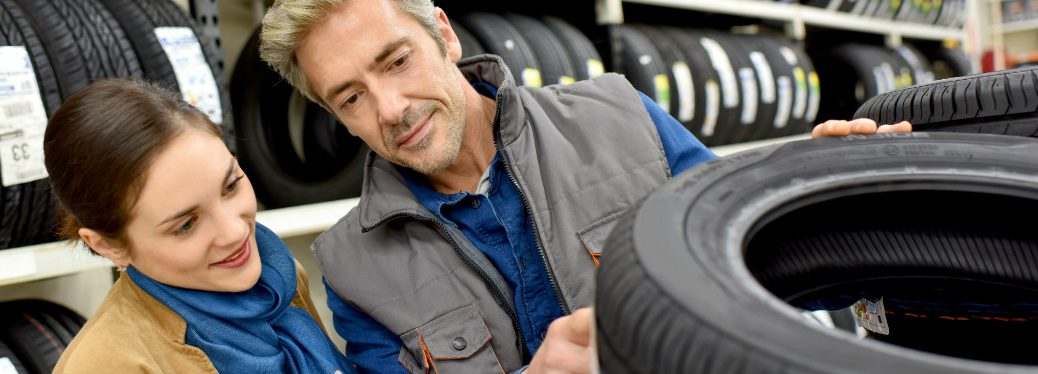 Customer choosing a tire at the store