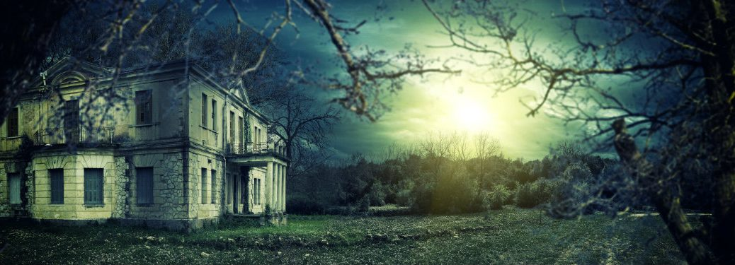 spooky house at sunset, dying trees outside