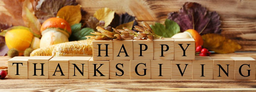 happy thanksgiving written with wooden blocks