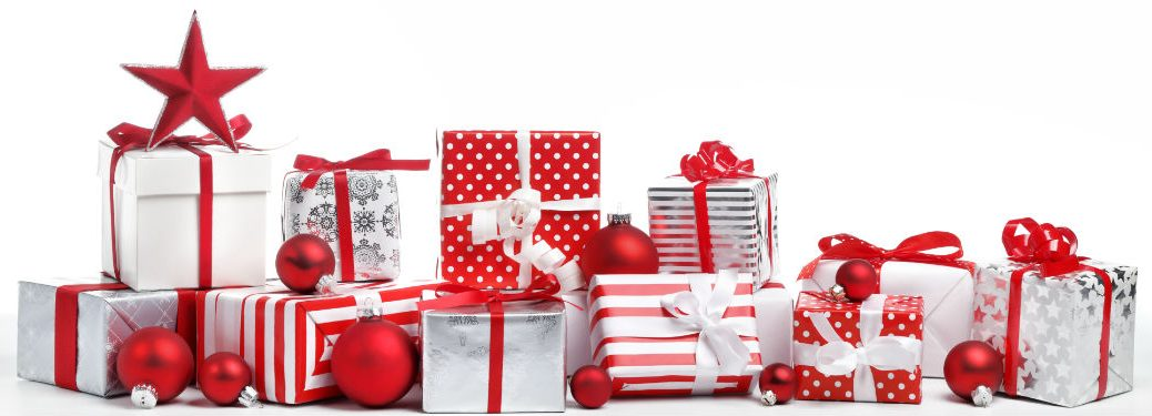 pile of red and white gifts with ornaments scattered throughout