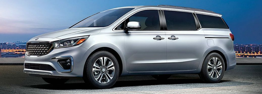 2020 Kia Sedona driver side front fascia city background-