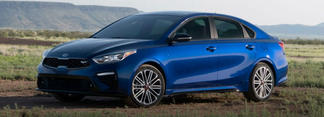 2020-Kia-Forte-blue-exterior-front-fascia-driver-side-parked-in-field_o