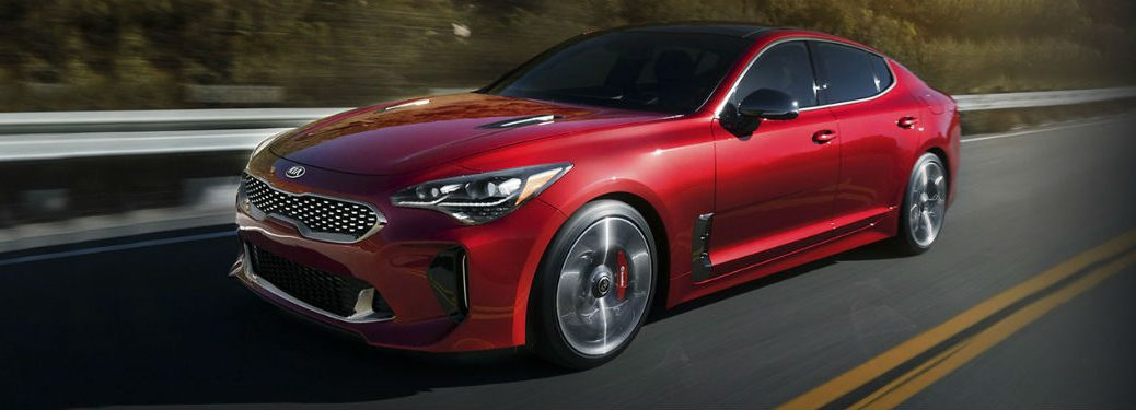2020 Kia Stinger red exterior front fascia driver side driving