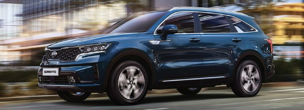 The front and side view of a blue 2021 Kia Sorento.