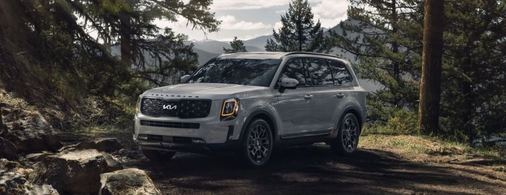 2022 Kia Telluride in the forest front and side view