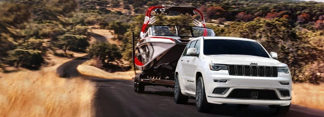 2021 Jeep Grand Cherokee towing a large boat