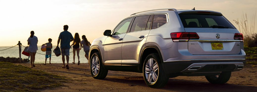 2019 Volkswagen Atlas from behind with people at beach