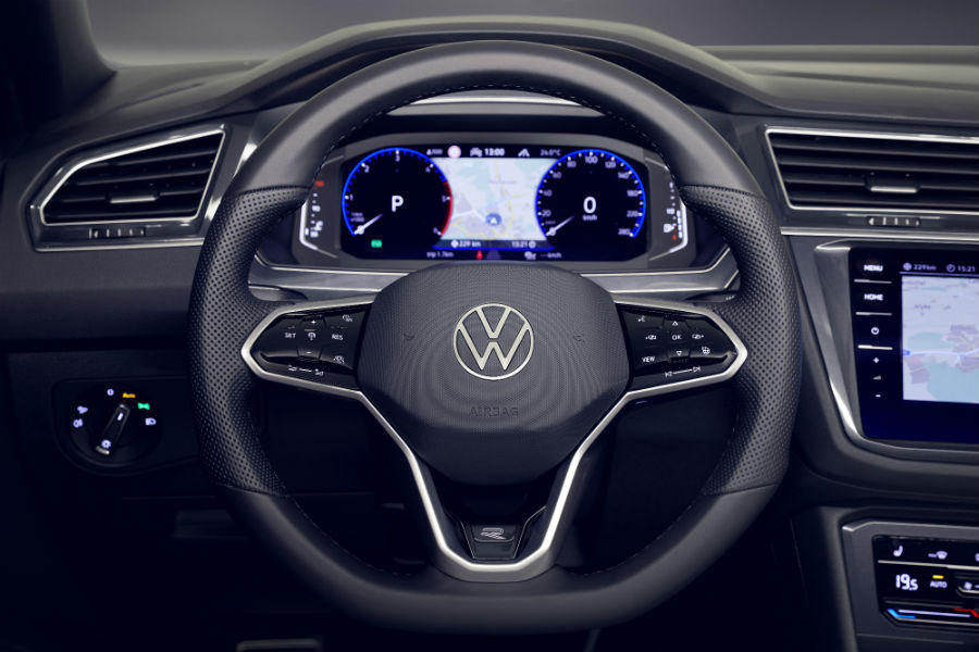 A photo of one VW Digital Cockpit screen configuration showing a speedometer, tachometer and navigation.