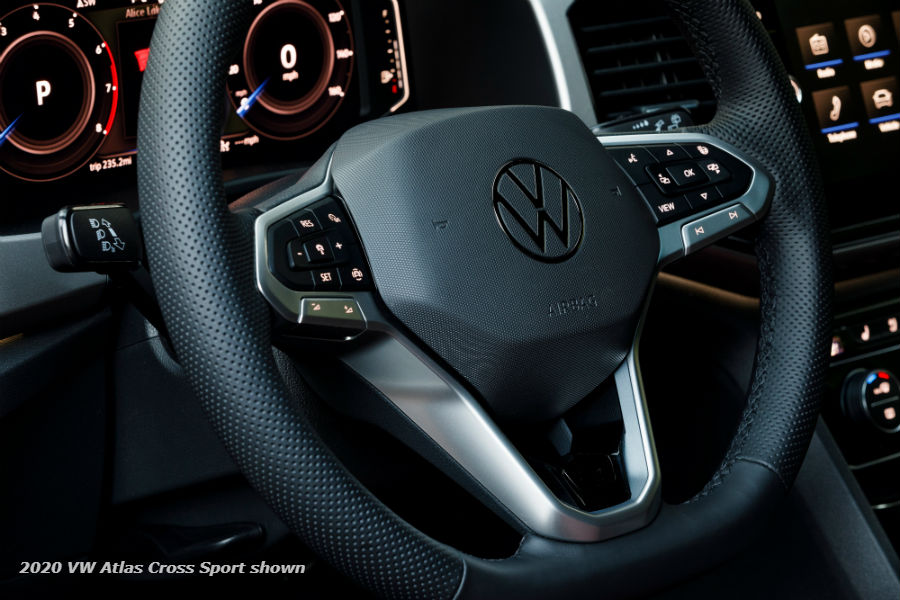 A photo of the steering wheel and digital gauge cluster in the 2020 VW Atlas Cross Sport used for illustrative purposes only.