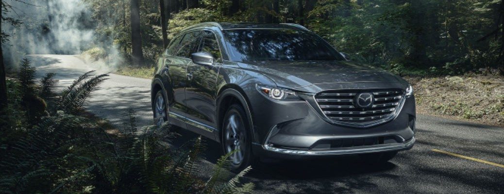 2021 Mazda CX-9 driving down a forest road