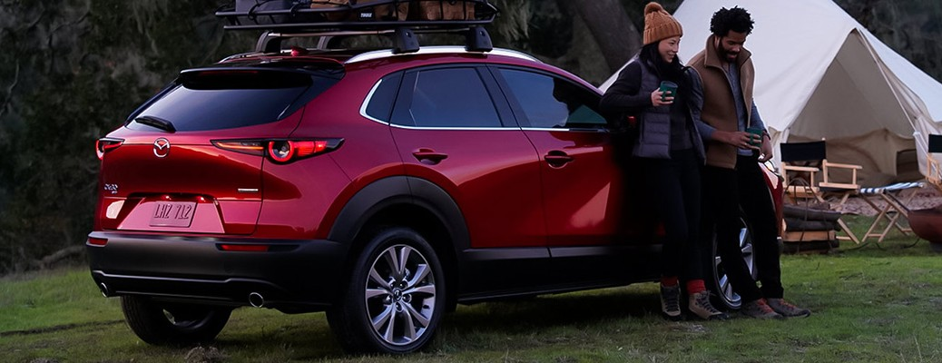 Two people standing next to the 2021 Mazda CX-30