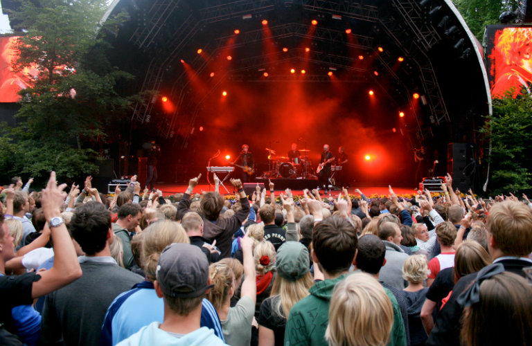 crowd facing concert on stage