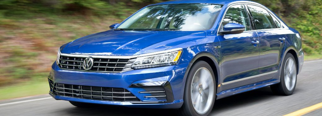 blue volkswagen passat driving on road