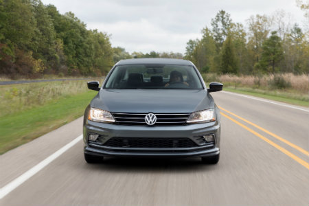 2018 Volkswagen Jetta driving down a country road