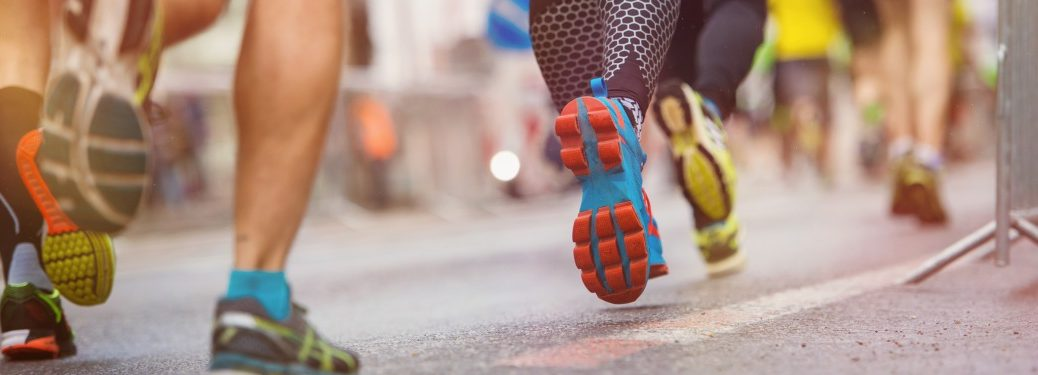Close-up on runners' feet as they race