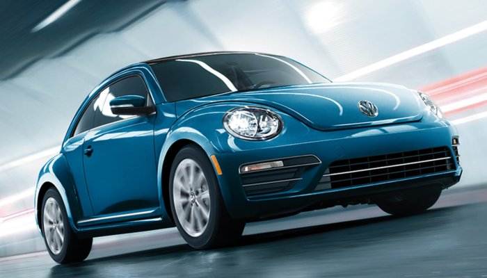 2019 Volkswagen Beetle Final Edition driving down a tunnel