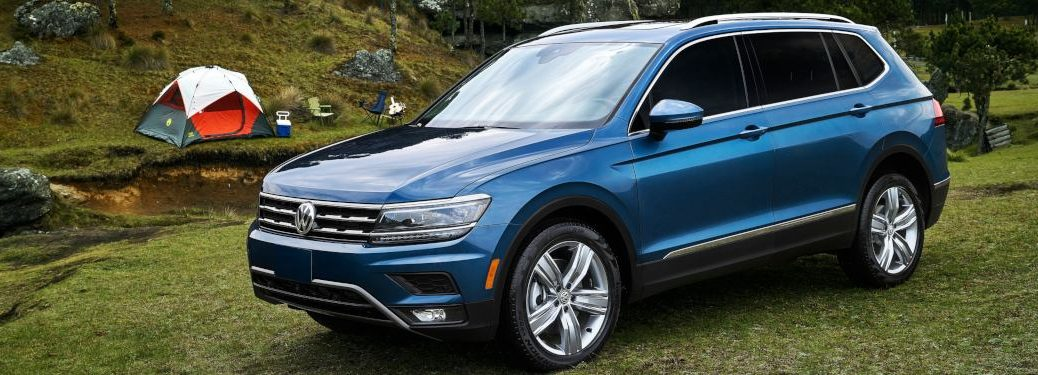 2019 Volkswagen Tiguan parked in front of a campsite.