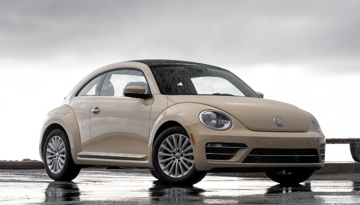 2019 Volkswagen Beetle parked on a beach