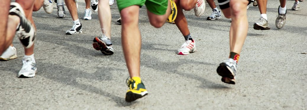 A close-up on the legs of a group of runners