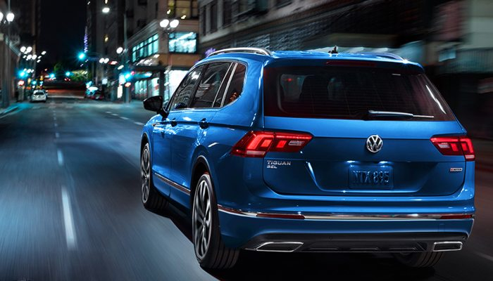 2020 Volkswagen Tiguan driving down a city street