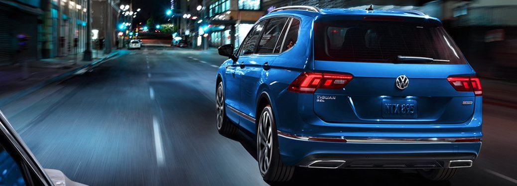 2020 Volkswagen Tiguan driving down a city street at night