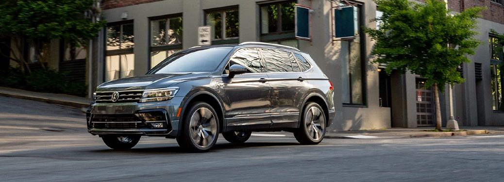 The front image of a gray 2020 Volkswagen Tiguan parked in a city area.