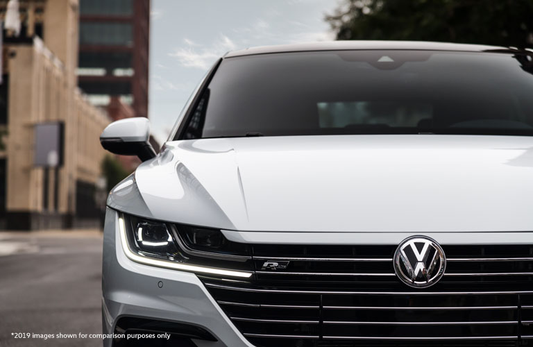 A front grille image of the 2020 Volkswagen Arteon parked on a city road.
