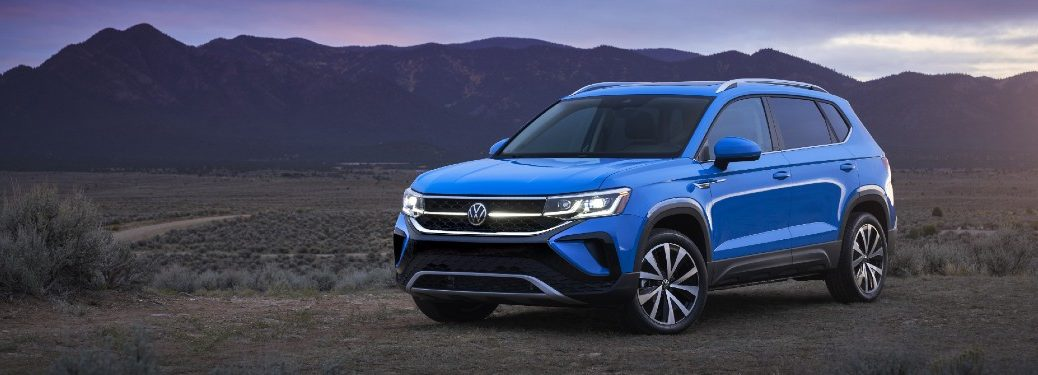 The front and side image of a blue 2022 Volkswagen Taos.