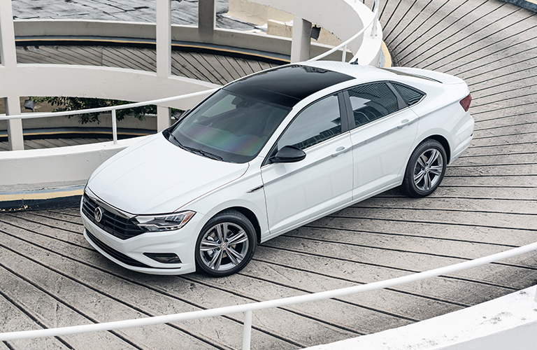 The front and side view of a white 2021 Volkswagen Jetta.