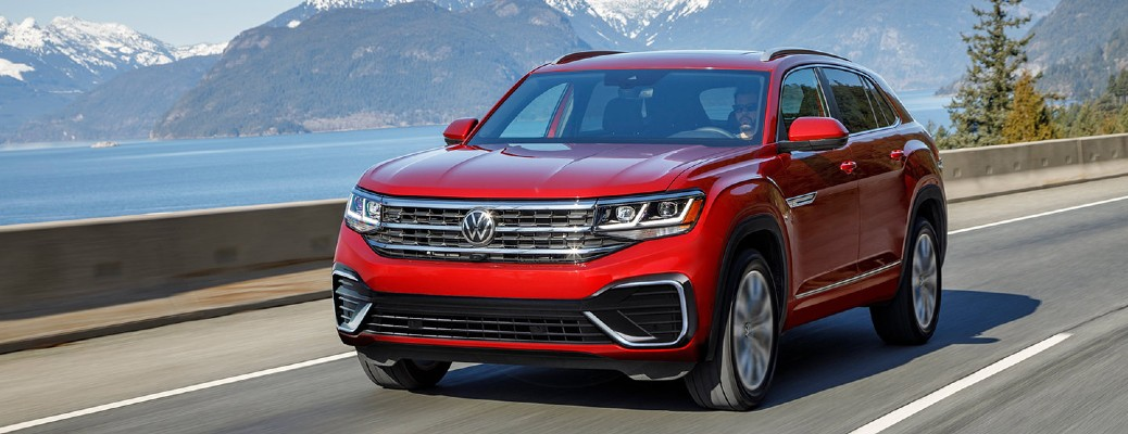 The front and side view of a red 2021 Volkswagen Atlas Cross Sport.