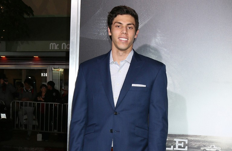 Christian Yelich in a suite at a movie premier.